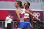 Sydney McLaughlin of the United States, left, celebrates with teammate Dalilah Muhammad after winning the final of the women's 400-meter hurdles at the 2020 Summer Olympics, Wednesday, Aug. 4, 2021, in Tokyo. (AP Photo/Matthias Schrader)