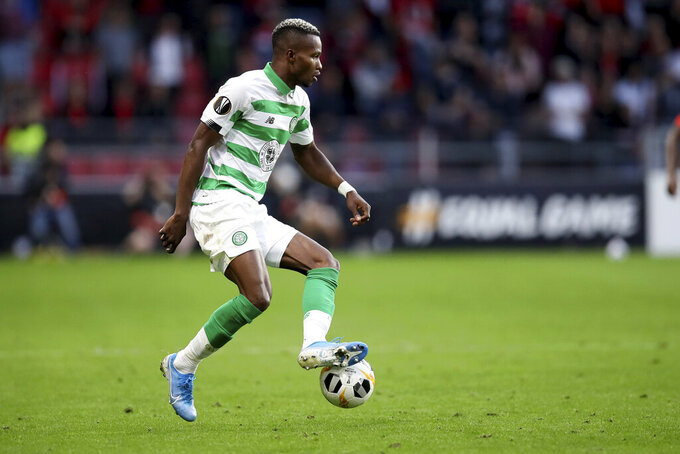 """FILE - In this Thursday, Sept. 19, 2019 file photo, Celtic's Boli Bolingoli-Mbombo controls the ball during the Europa League Group E soccer match between Rennes and Celtic, at the Roazhon Park stadium in Rennes, France. Scottish soccer is in danger of being halted by the country's government after a Celtic player breached coronavirus rules by taking a secret trip to Spain and failing to self-isolate on his return. The Scottish champions have begun a """"full investigation"""" into the actions of left back Boli Bolingoli, it was reported on Tuesday, Aug. 11, 2020. (AP Photo/David Vincent, File)"""