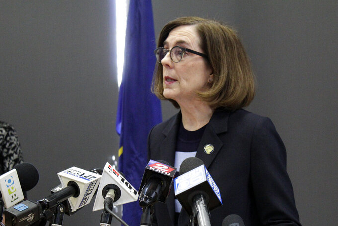 Gov. Kate Brown speaks at a news conference to announce a four-week ban on eat-in dining at bars and restaurants throughout the state Monday, March 16, 2020, in Portland, Ore. Restaurants can still offer take-out and delivery. The order is intended to slow the spread of the new coronavirus in Oregon and mirrors similar bans elsewhere, including Washington state. (AP Photo/Gillian Flaccus)