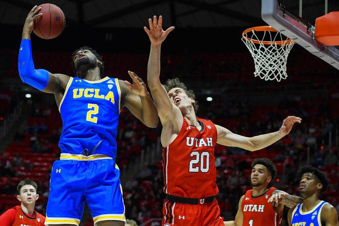 UCLA forward Cody Riley (2) grabs a rebound over Utah forward Mikael Jantunen (20) during the first half of an NCAA college basketball game Thursday, Feb. 20, 2020, in Salt Lake City. (AP Photo/Alex Goodlett)