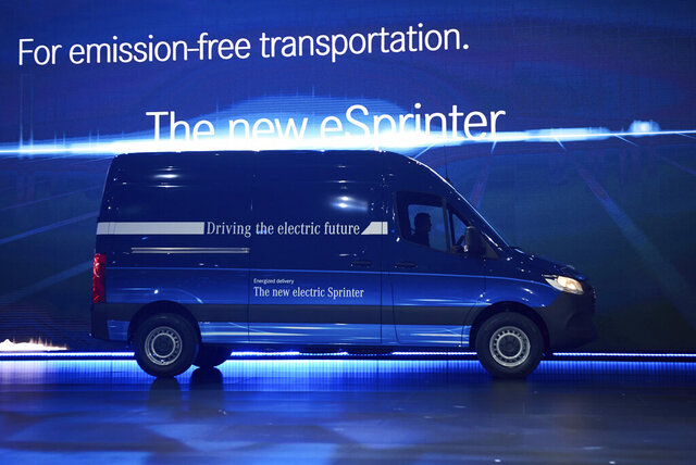 FILE - In this Feb.6, 2018 file photo, an electric version of the model of the Mercedes van Sprinter, the eSprinter, driving onstage in Duisburg, Germany. Amazon says it's buying 1,800 electric delivery vans from Mercedes-Benz, the biggest such order for the German automaker to date. Mercedes says it will also join a climate initiative established by Amazon's founder Jeff Bezos, committing itself to going completely carbon neutral by 2039. (Bernd Thissen/dpa via AP)