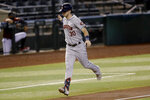 Houston Astros' Kyle Tucker (30) rounds the bases after hitting a two run home run against the Arizona Diamondbacks during the second inning of a baseball game Wednesday, Aug. 5, 2020, in Phoenix. (AP Photo/Matt York)