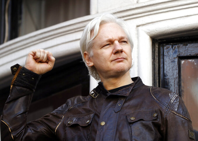 FILE - In this Friday May 19, 2017 file photo, Julian Assange greets supporters outside the Ecuadorian embassy in London. Britain's High Court on Wednesday July 7, 2021, has granted the U.S. government permission to appeal a decision that WikiLeaks founder Julian Assange cannot be sent to the United States to face espionage charges. (AP Photo/Frank Augstein, File)
