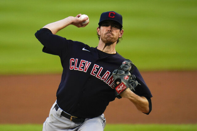 Cleveland Indians pitcher Shane Bieber throws against the Detroit Tigers in the first inning of a baseball game in Detroit, Thursday, Sept. 17, 2020. (AP Photo/Paul Sancya)