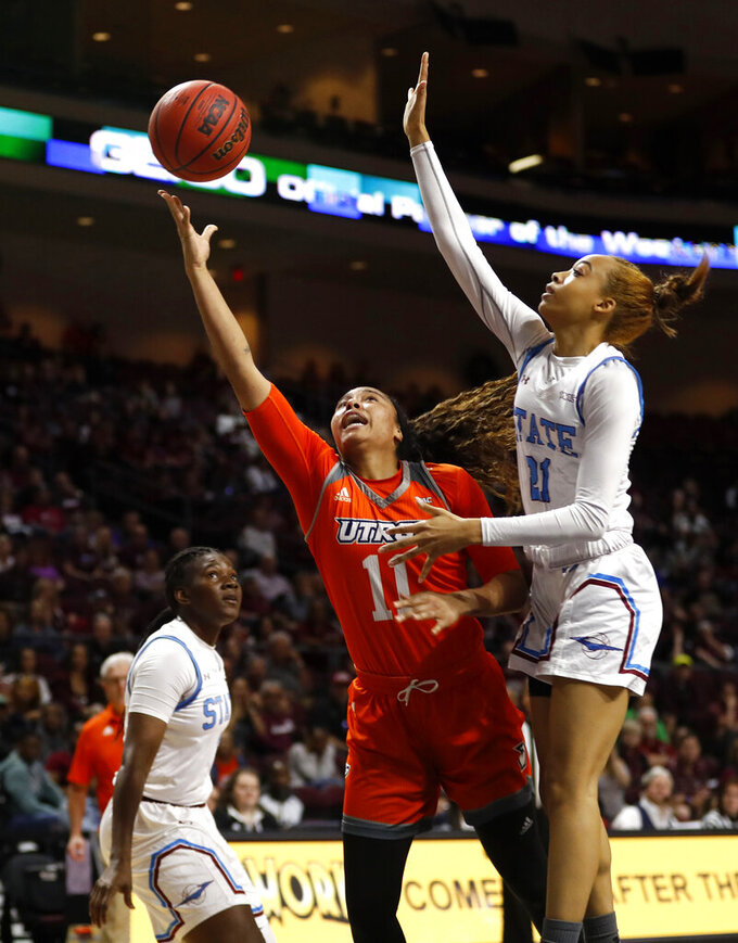 Texas-Rio Grande Valley guard Quynne Huggins (11) lays up the ball past New Mexico State guard Monique Mills (21) during a NCAA college basketball Western Athletic Conference Women's Tournament championship game Saturday, March 16, 2019, in Las Vegas. (AP Photo/Steve Marcus)