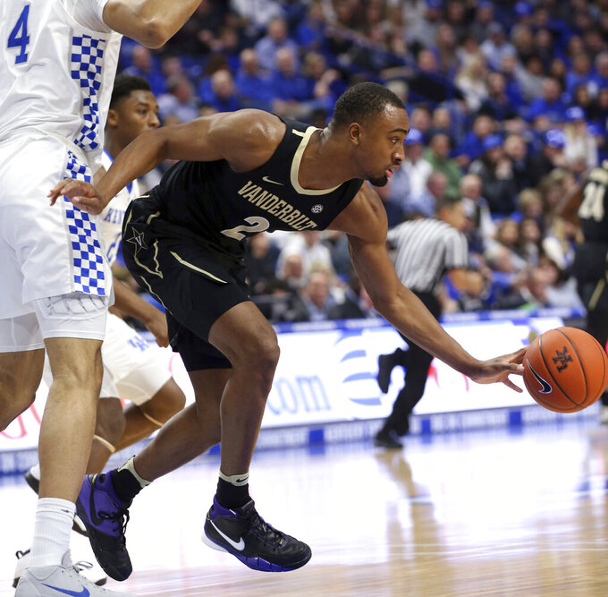 Vanderbilt's Joe Toye (2) drives around Kentucky's Nick Richards (4) during the first half of an NCAA college basketball game in Lexington, Ky., Saturday, Jan. 12, 2019. (AP Photo/James Crisp)
