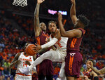 Clemson's Marcquise Reed (2) tries to pass while defended by Virginia Tech's Isaiah Wilkins, right, and Ty Outlaw during the first half of an NCAA college basketball game Saturday, Feb. 9, 2019, in Clemson, S.C.. (AP Photo/Richard Shiro)