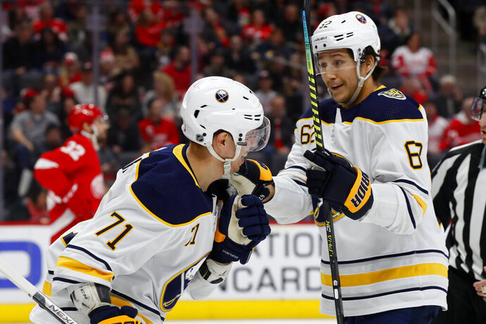 Buffalo Sabres left wing Evan Rodrigues (71) celebrates his goal with Brandon Montour in the first period of an NHL hockey game against the Detroit Red Wings, Sunday, Jan. 12, 2020, in Detroit. (AP Photo/Paul Sancya)