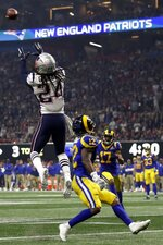 New England Patriots' Stephon Gilmore (24) intercepts a pass intended for Los Angeles Rams' Brandin Cooks (12), during the second half of the NFL Super Bowl 53 football game Sunday, Feb. 3, 2019, in Atlanta. (AP Photo/Jeff Roberson)