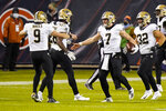 New Orleans Saints quarterback Taysom Hill (7) is congratulated by quarterback Drew Brees (9) after a touchdown against the Chicago Bears in the second half of an NFL football game in Chicago, Sunday, Nov. 1, 2020. (AP Photo/Nam Y. Huh)