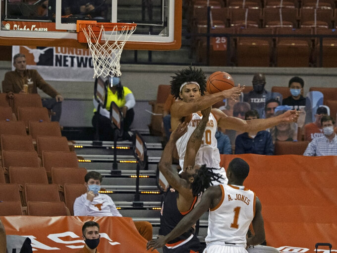 Texas forward Jericho Sims (20) blocks the shot of Sam Houston State guard Dante Powers during the first half of an NCAA college basketball game, Wednesday, Dec. 16, 2020, in Austin, Texas. (AP Photo/Michael Thomas)