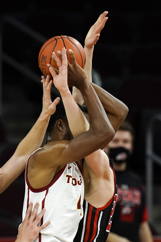 Southern California's Evan Mobley, left, is defended by Utah's Mikael Jantunen during the first half of an NCAA college basketball game, Saturday, Jan. 2, 2021, in Los Angeles. (AP Photo/Jae C. Hong)