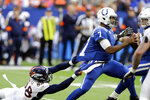 Indianapolis Colts quarterback Jacoby Brissett (7) runs out of a tackle by Denver Broncos outside linebacker Von Miller (58) during the second half of an NFL football game, Sunday, Oct. 27, 2019, in Indianapolis. (AP Photo/Darron Cummings)