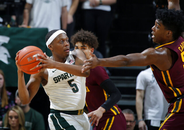 Michigan State's Cassis Winston, left, is pressured by Minnesota's Marcus Carr during the first half of an NCAA college basketball game Thursday, Jan. 9, 2020, in East Lansing, Mich. (AP Photo/Al Goldis)