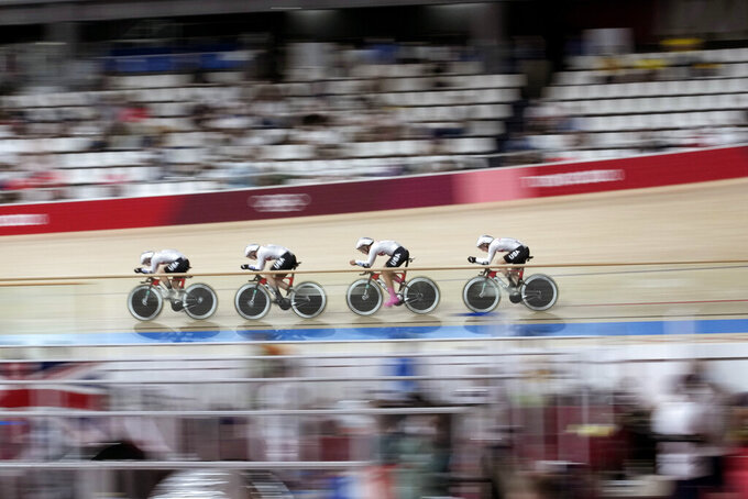 Team Britain competes during the track cycling women's team pursuit at the 2020 Summer Olympics, Monday, Aug. 2, 2021, in Izu, Japan. (AP Photo/Christophe Ena)