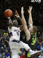 Connecticut's Sidney Wilson (15) shoots at the basket as South Florida's Antun Maricevic (34), of Croatia, tries to block him during the second half of an NCAA college basketball game, Sunday, March 3, 2019, in Storrs, Conn. (AP Photo/Steven Senne)