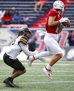 South Alabama wide receiver Cade Sutherland (12) hauls in a pass defended by Appalachian State defensive back Nicholas Ross (26) during the second half of an NCAA college football game Saturday, Oct. 26, 2019, at Ladd-Peebles Stadium in Mobile, Ala. (AP Photo/Julie Bennett)