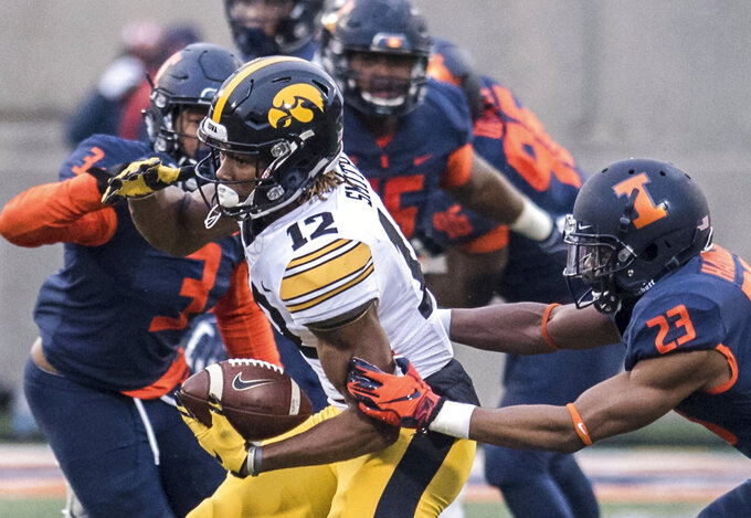 Iowa's Brandon Smith runs with the ball in the first half of a NCAA college football game against Illinois, Saturday, Nov. 17, 2018, in Champaign, Ill. (AP Photo/Holly Hart)
