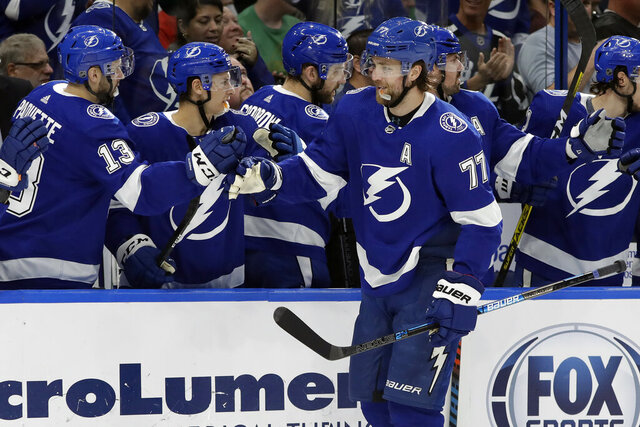 Tampa Bay Lightning defenseman Victor Hedman (77) celebrates with the bench after scoring against the Montreal Canadiens during the first period of an NHL hockey game Thursday, March 5, 2020, in Tampa, Fla. (AP Photo/Chris O'Meara)
