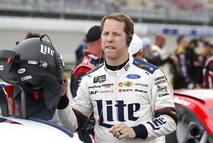 Brad Keselowski prepares for the NASCAR cup series auto race at Michigan International Speedway, Monday, June 10, 2019, in Brooklyn, Mich. (AP Photo/Carlos Osorio)