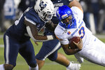 Utah State linebacker Kevin Meitzenheimer tackles Boise State quarterback Jaylon Henderson (9) during the first half of an NCAA college football game Saturday, Nov. 23, 2019, in Logan, Utah. (AP Photo/Eli Lucero)