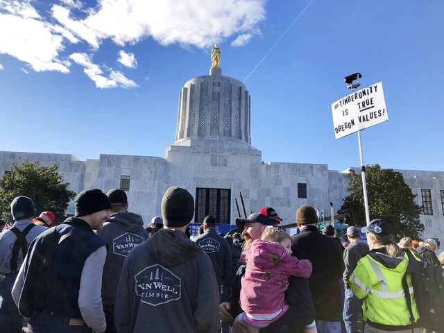 Demonstrators protest against a cap-and-trade bill aimed at stemming global warming protest on Thursday, Feb. 6, 2020 at the Oregon State Capitol in Salem. Truckers from across Oregon come to the state Capitol to protest environmental legislation being considered by lawmakers. Truckers say the measure would increase costs of doing business in rural communities. (AP Photo/Andrew Selsky)