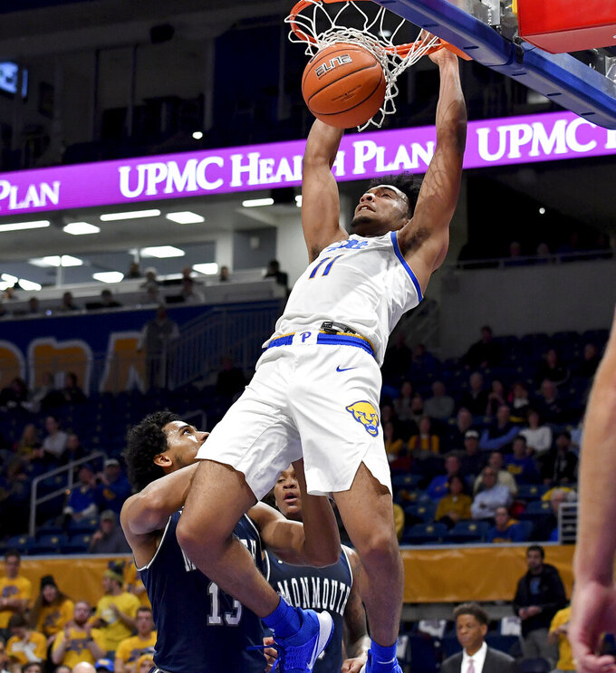 Pitt guard Justin Champagnie dunks against Monmouth in the first half of an NCAA college basketball game Monday, Nov. 18, 2019, in Pittsburgh, Pa. (Matt Freed/Pittsburgh Post-Gazette via AP)