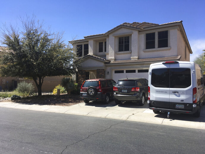 The home of Machelle Hobson in Maricopa, Ariz., is pictured on Wednesday, March 20, 2019. Hobson, 48, who operates a popular YouTube channel aimed at kids, is facing allegations she used pepper spray to discipline her seven adopted children and locked them for days inside a closet. (AP Photo/Terry Tang)