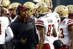 Boston College interim head coach Rich Gunnell talks with players in a timeout during the first half of the Birmingham Bowl NCAA college football game against Cincinnati, Thursday, Jan. 2, 2020, in Birmingham, Ala. (AP Photo/Butch Dill)