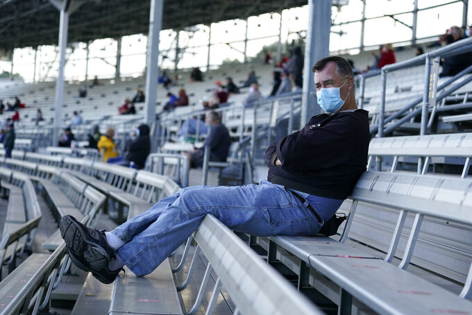 Fans watch during a practice session for an IndyCar auto race at Indianapolis Motor Speedway, Thursday, Oct. 1, 2020, in Indianapolis. (AP Photo/Darron Cummings)