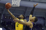 Baylor guard Jared Butler (12) goes up for a shot against TCU forward Jaedon LeDee (23) during the first half an NCAA college basketball game on Saturday, Feb. 29, 2020 in Fort Worth, Texas. (AP Photo/Richard W. Rodriguez)