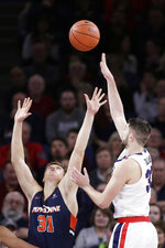 Gonzaga forward Killian Tillie, right, shoots over Pepperdine forward Jan Zidek during the first half of an NCAA college basketball game in Spokane, Wash., Saturday, Jan. 4, 2020. (AP Photo/Young Kwak)
