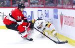 Vegas Golden Knights Nicolas Roy (10) fights for the puck against Ottawa Senators Colin White (36) during the first period of an NHL hockey game, Thursday, Jan. 16, 2020 in Ottawa, Ontario. (Sean Kilpatrick/The Canadian Press via AP)