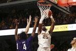 Minnesota's Daniel Oturu shoots the ball against Northwestern's Jared Jones during an NCAA college basketball game Sunday, Jan. 5, 2020, in Minneapolis. (AP Photo/Stacy Bengs)