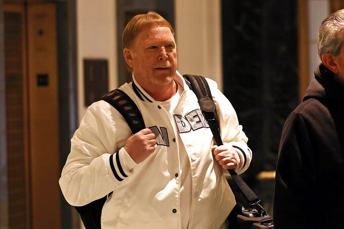 Mark Davis, owner of the Las Vegas Raiders, leaves the NFL owners meeting in New York, Wednesday, Oct. 27, 2021. (AP Photo/Adam Hunger)