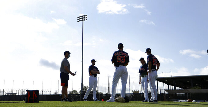 Houston Astros pitchers stand on the field during baseball spring training in West Palm Beach, Fla., Tuesday, Feb. 23, 2021. (Karen Warren/Houston Chronicle via AP)