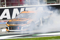 Kurt Busch smokes his tires doing a burnout after winning NASCAR Cup Series auto race, Sunday, July, 11, 2021, in Hampton, Ga. (AP Photo/John Amis)