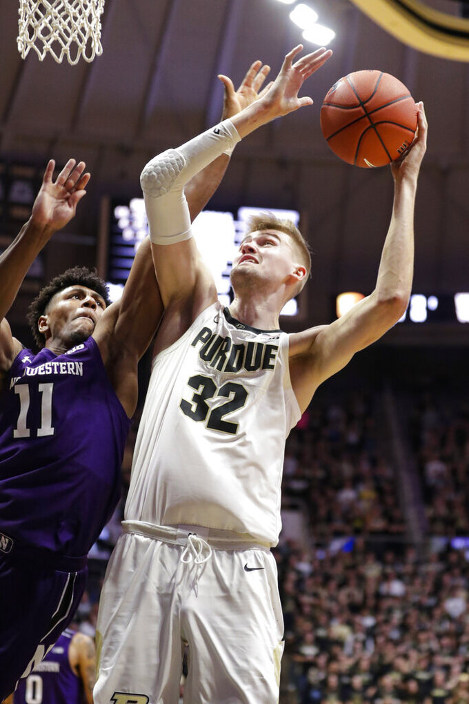 Purdue center Matt Haarms (32) shoots over Northwestern guard Anthony Gaines (11) during the second half of an NCAA college basketball game in West Lafayette, Ind., Sunday, Dec. 8, 2019. Purdue defeated Northwestern 58-44. (AP Photo/Michael Conroy)