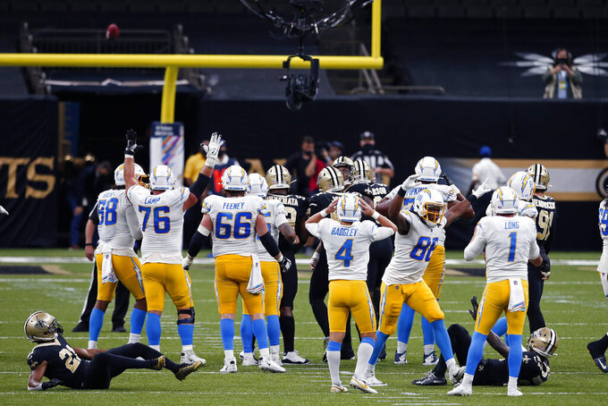 Los Angeles Chargers kicker Mike Badgley (4) reacts as his field goal attempt at the end of regulation hit the upright, forcing overtime, in the second half of an NFL football game against the New Orleans Saints in New Orleans, Monday, Oct. 12, 2020. (AP Photo/Butch Dill)