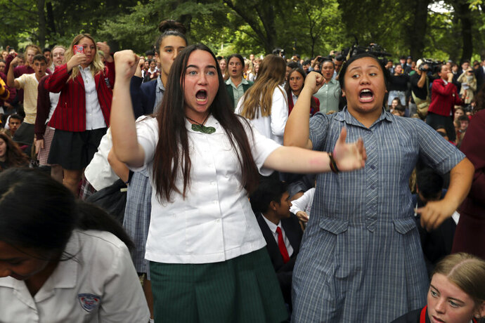 Students perform the Haka during a vigil to commemorate victims of Friday's shooting, outside the Al Noor mosque in Christchurch, New Zealand, Monday, March 18, 2019. Three days after Friday's attack, New Zealand's deadliest shooting in modern history, relatives were anxiously waiting for word on when they can bury their loved ones. (AP Photo/Vincent Thian)