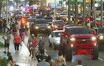In this June 12, 2021 photo, Daytona Truck Meet, enthusiasts pack Atlantic Avenue and sidewalk near the Ocean Center, in Daytona Beach, Fla. (David Tucker/The Daytona Beach News-Journal via AP)