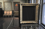 """FILE - In this March 11, 2010 file photo, empty frames from which thieves took """"Storm on the Sea of Galilee,"""" left background, by Rembrandt and """"The Concert,"""" right foreground, by Vermeer, remain on display at the Isabella Stewart Gardner Museum in Boston. The paintings were among more than a dozen works stolen from the museum March 21, 1990, in what is considered the largest art theft in history. The chief investigator for a Boston museum still working to recover $500 million worth of art stolen in 1990 said Thursday that he was hoping for new leads to emerge following the death of a key figure in the case. (AP Photo/Josh Reynolds, File)"""