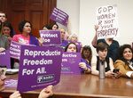 "File-Supporters crowd a meeting room before a roundtable discussion at the Georgia State Capitol in Atlanta on Thursday, May 16, 2019, to discuss abortion bans in Georgia and across the country. A federal judge is permanently blocking Georgia's 2019 ""heartbeat"