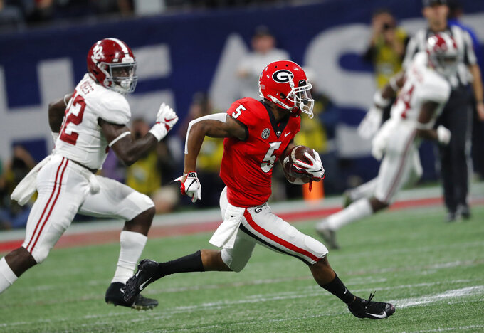 Georgia wide receiver Terry Godwin (5) runs against Alabama linebacker Dylan Moses (32) during the first half of the Southeastern Conference championship NCAA college football game, Saturday, Dec. 1, 2018, in Atlanta. (AP Photo/John Bazemore)