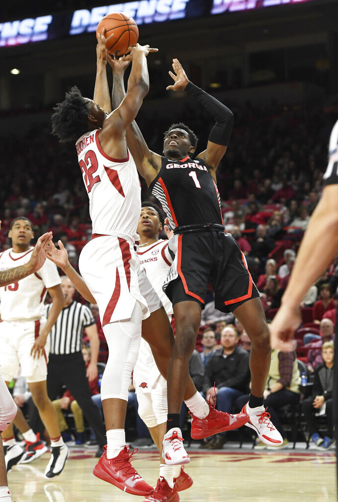 Georgia guard William Jackson II (1) shoots over Arkansas defender Gabe Osabuohien (22) during the second half of an NCAA college basketball game, Tuesday, Jan.29, 2019 in Fayetteville, Ark. (AP Photo/Michael Woods)