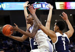 DePaul forward Paul Reed, left, drives to the basket against Butler forwards Jordan Tucker (1) and Christian David during the second half of an NCAA college basketball game Wednesday, Jan. 16, 2019, in Chicago. Butler won 87-69. (AP Photo/Nam Y. Huh)