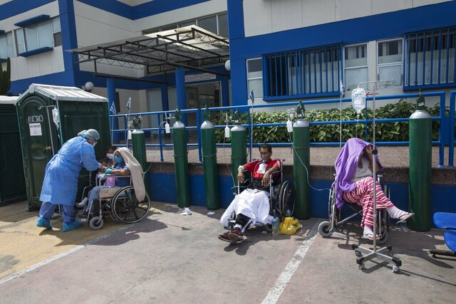 People infected with COVID-19 disease wait for an available bed, outside a public hospital in Lima, Peru, Thursday, April 30, 2020. (AP Photo/Rodrigo Abd)