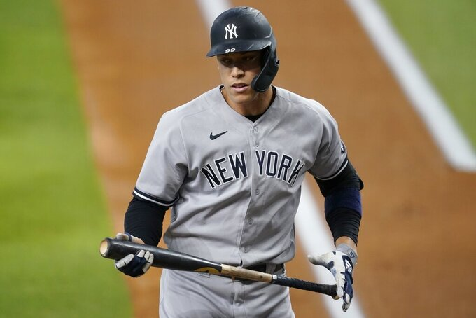 New York Yankees' Aaron Judge turns to the dugout after striking out in the first inning of a baseball game against the Texas Rangers in Arlington, Texas, Monday, May 17, 2021. (AP Photo/Tony Gutierrez)