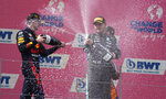 First place Red Bull driver Max Verstappen of the Netherlands, left, jubilates on the podium with second place Mercedes driver Valtteri Bottas of Finland during the Austrian Formula One Grand Prix at the Red Bull Ring racetrack in Spielberg, Austria, Sunday, July 4, 2021. (AP Photo/Darko Bandic)