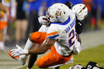 Boise State running back Andrew Van Buren (21) is bought down by Central Florida defensive back Davonte Brown during the first half of an NCAA college football game Thursday, Sept. 2, 2021, in Orlando, Fla. (AP Photo/John Raoux)